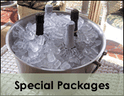four champagne bottles in silver bucket with ice on table