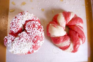 two red and white bagels one with white toppings the other with no toppings