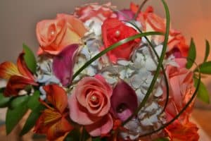 Bridal bouqet with orange pink green white and purple flowers