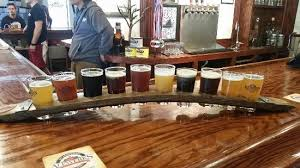 Flight of beers on a try on a wooden table