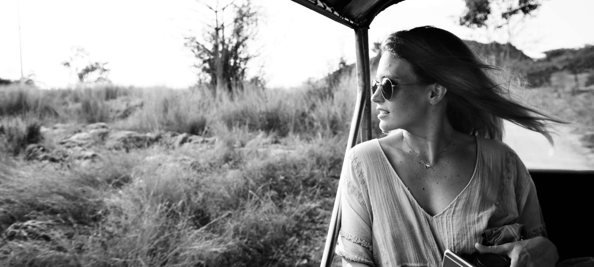 woman in a jeep touring nature