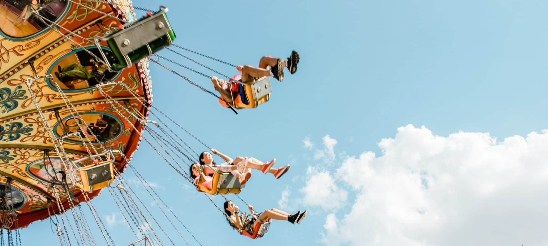 children on an amusement park swing ride