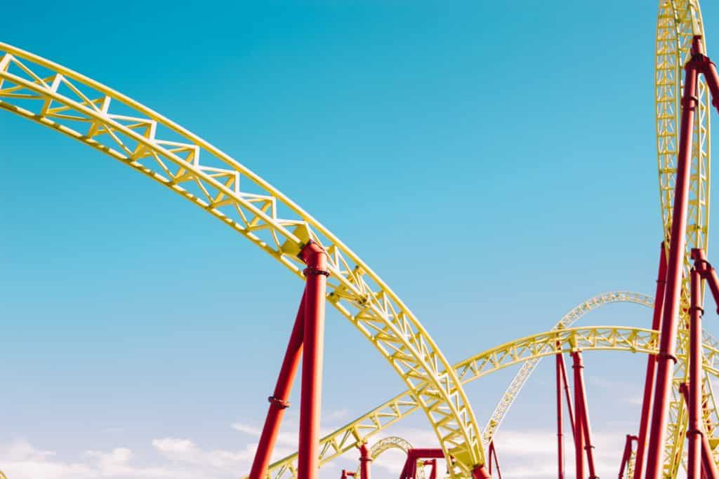yellow roller coaster tracks with a blue sky background