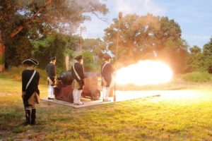 Revolutionary War reenactors firing a canon at Yorktown Settlement